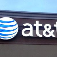 AT&T sells minority stake to buyout firm TPG Capital, trims debt